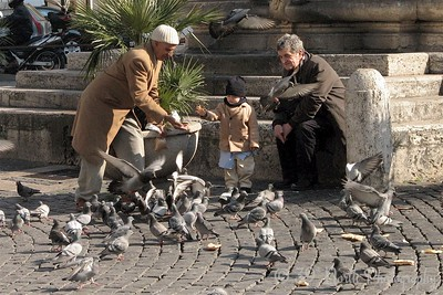 People and pigeons in front of the Basilica di Santa Maria Maggiore