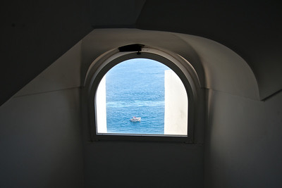Boat framed in hotel's window, Amalfi