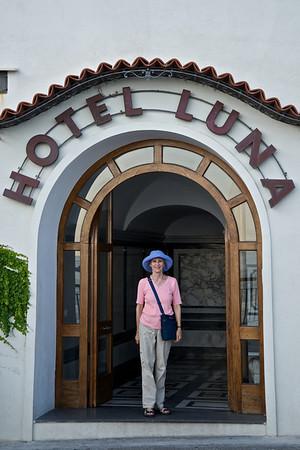 Kathie framed in hotel archway, Amalfi
