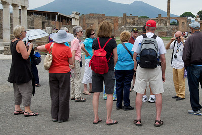 Group listens to guide, Pompeii