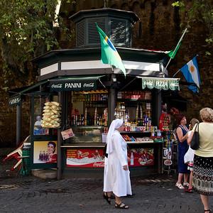 Nun on street next to St. Peter's Basilica, Rome