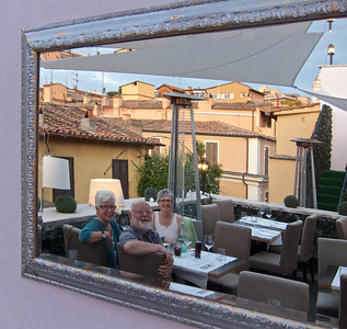 Cecie, Hal, and Kathie reflected in mirror, Rome