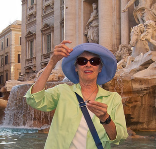 Kathie tossing a coin into Trevi Fountain, Rome