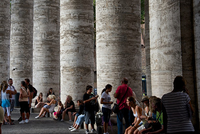 Tourists taking a rest, St Peter's Basilica Colonnade, Rome