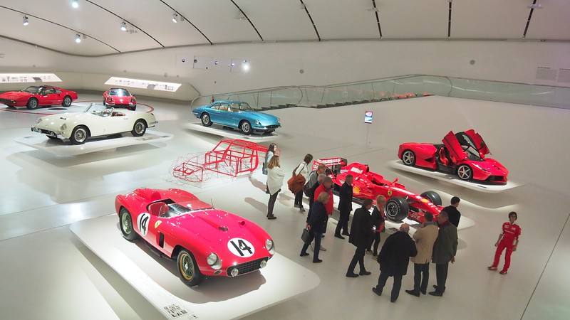 High vantage point shot of a Ferrari exhibit at the Enzo Ferrari Museum