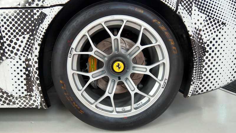 Wheel perspective shot of a Ferrari car at the Enzo Ferrari Museum