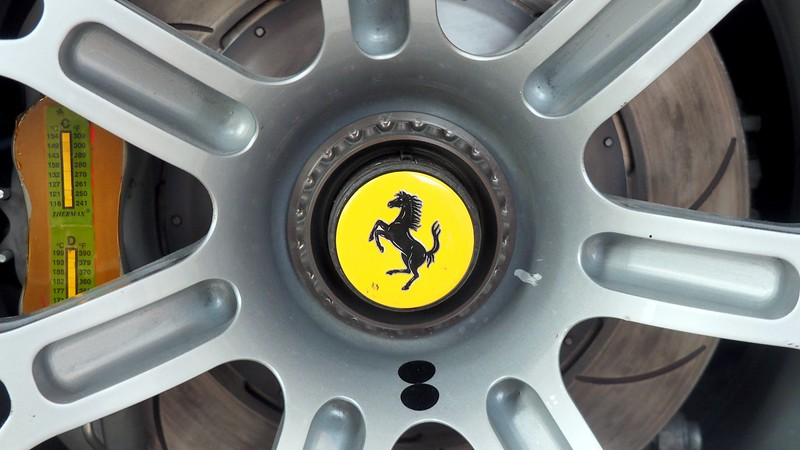 Ferrari logo close-up shot of a wheel at the Enzo Ferrari Museum