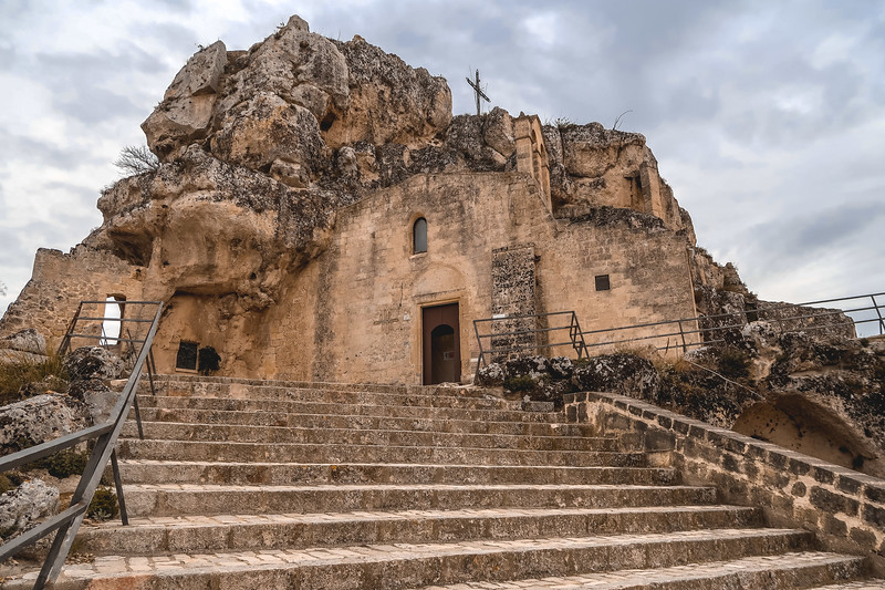 Matera's churches are carved into the rock and hold frescoes.