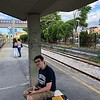 Aidan at Pompeii station — the narrow-guage CircumVesuviana train system