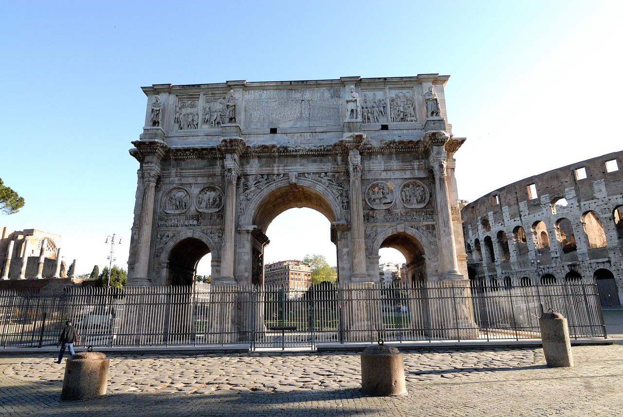 The Arch of Constantine, AD 315.  Built by Emperor Constantine to commemorate victory in a battle in AD 312 where he received a vision from heaven, and as a result converted himself, and all of the Roman Empire, to Christanity