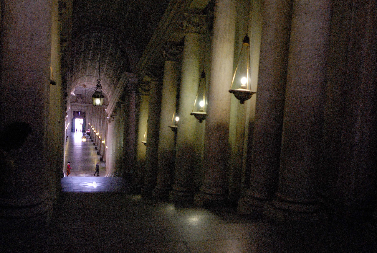 Outside the museum, a corridor leading to the private areas of the Vatican, and guarded by a Swiss Guard