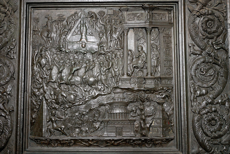 Depicting St Peter, who asked to be crucified upside down, and whose crucifiction is believed to have occured near St Peter's Square.