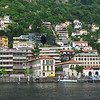 The town of Como, at Lake Como.  The Como–Brunate funicular is shown at the top right corner of the photo.