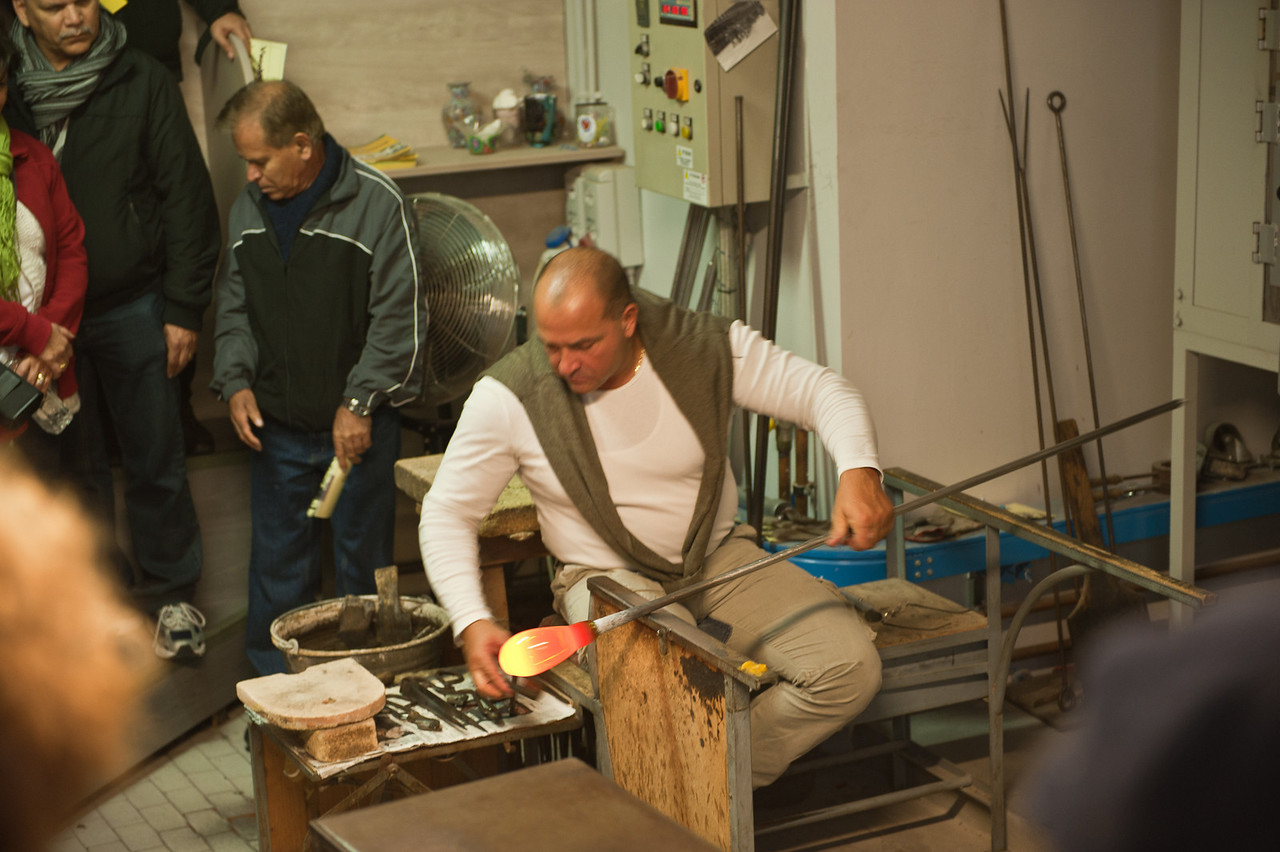 Murano glassblower in a demonstration for the tourist.
