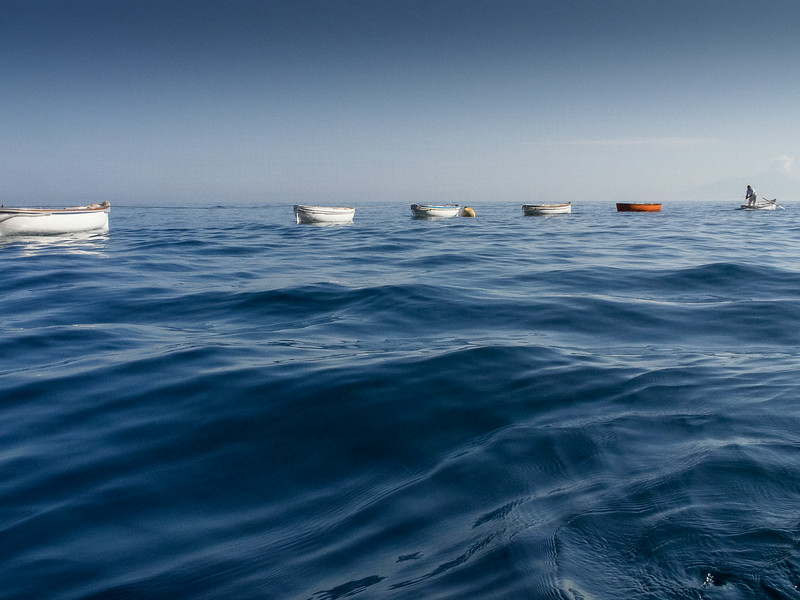 Capri - Line of Boats being towed to the Blue Grotto