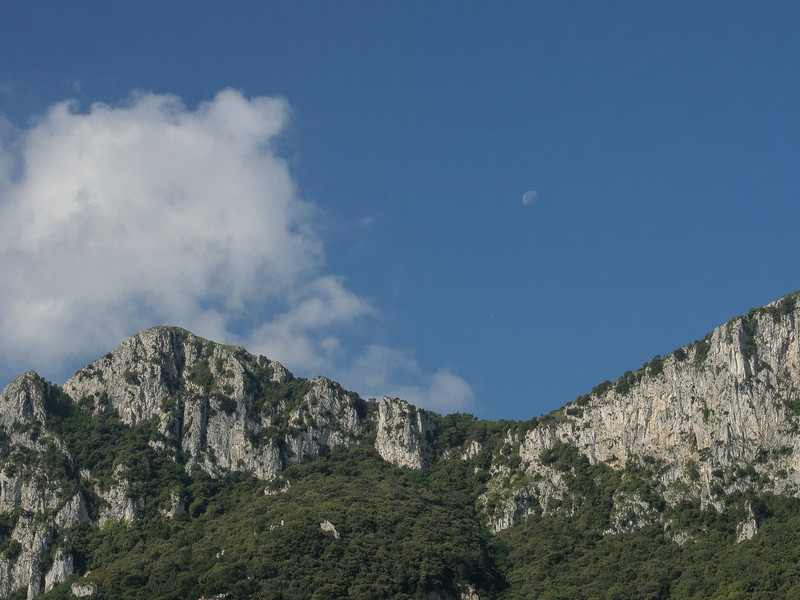 Capri from the Sea - Note moon above dip in the rocks