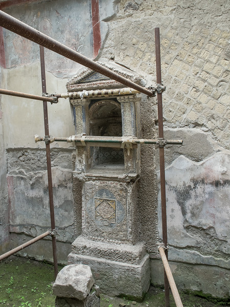 Shrine from the House of the Skeleton being restored