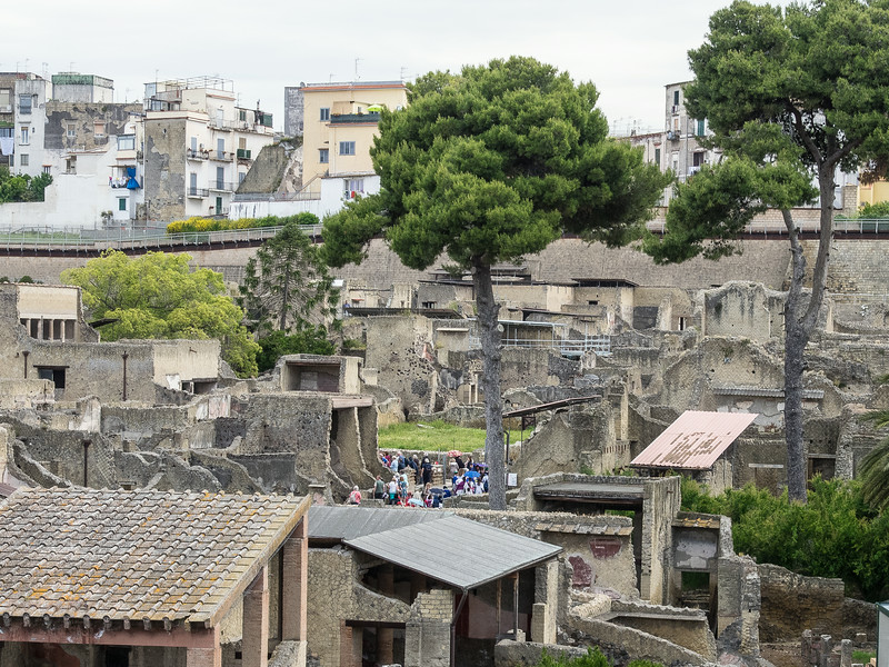 Herculaneum  (lowest level) destroyed by ash from a volcanic eruption of Mount Vesuvius in 79 AD.  Upper level (above the wall) is the Medieval city.  Covered by a fall of ash it charred rather than destroyed wood
