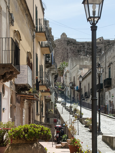 Lipari Street scene looking toward the Acropolis with Duomo and Castle