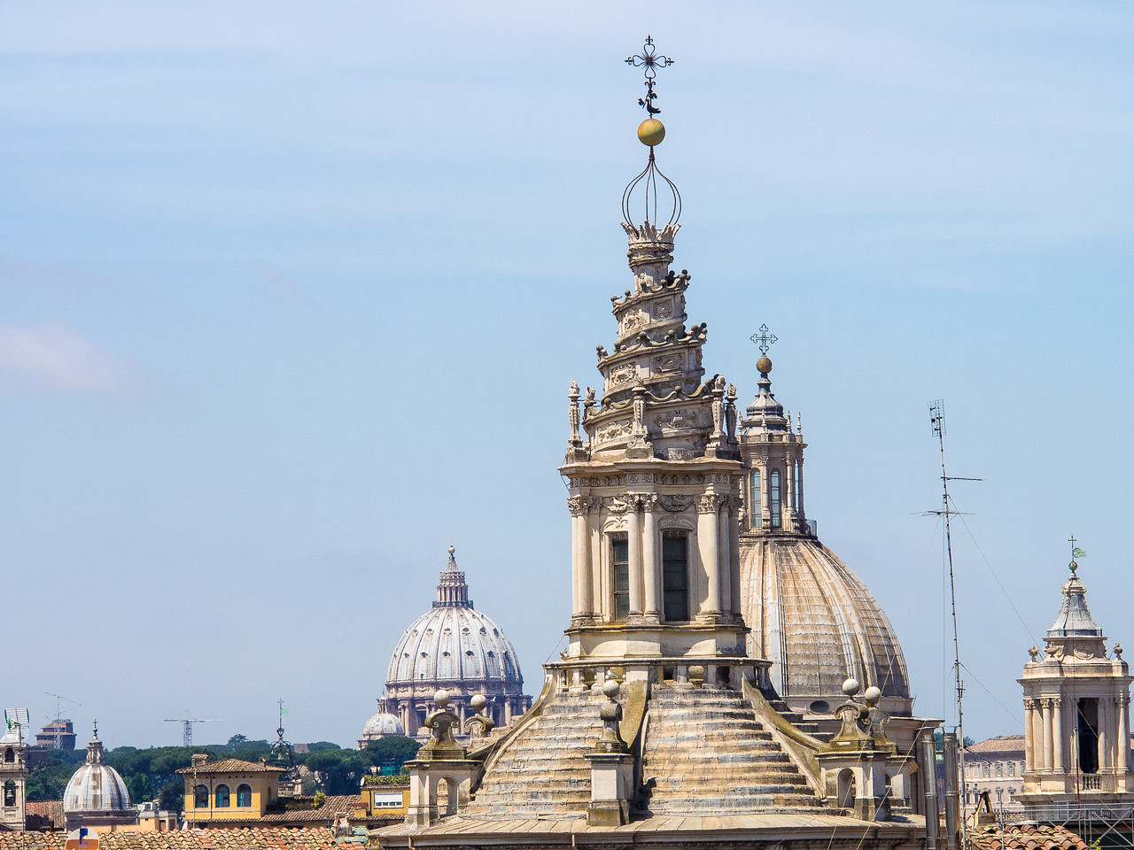 Church domes from the hotel roof garden closest with spiral is St. Ivo
