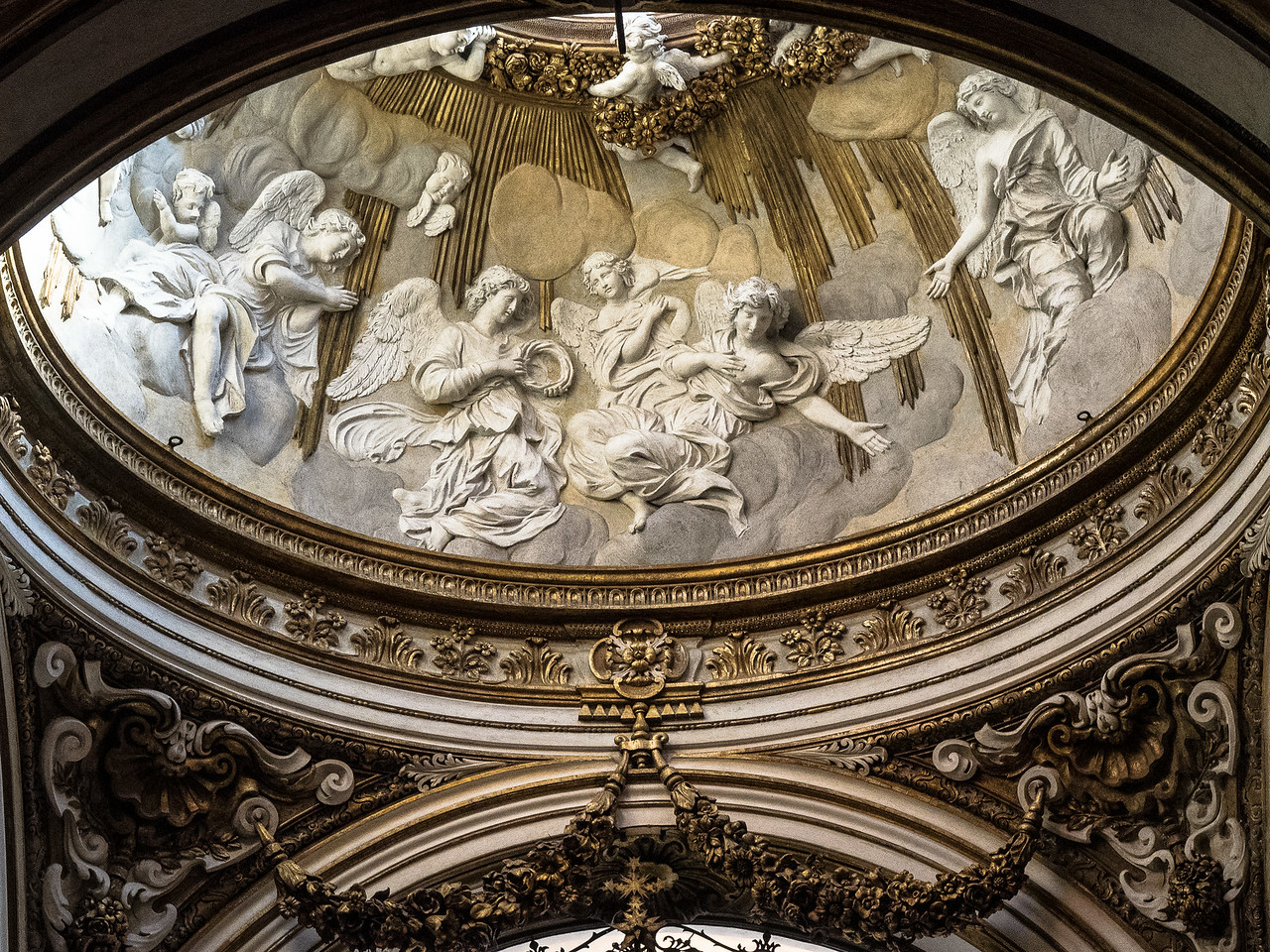 San Luigi - lower section of a dome with welcoming angels in the Chapel of San Luigi (King Louis IX)