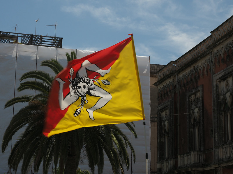 Flag of Sicily Legs mimic its triangular shape