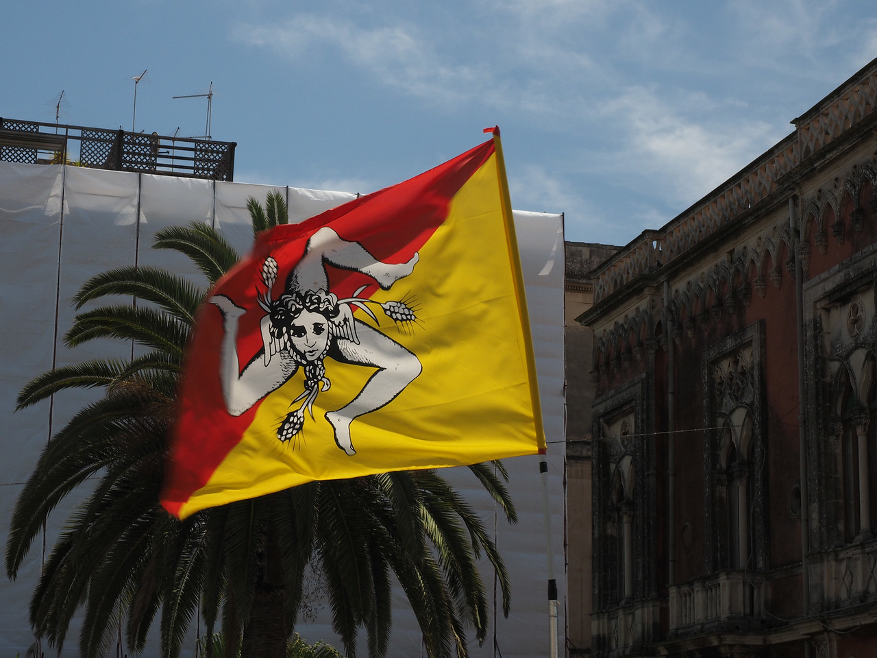 Flag of Sicily Legs mimic its triangular shape