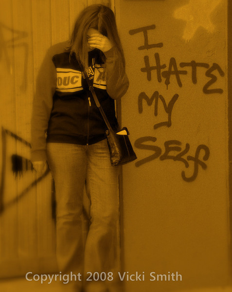 Bologna, Italy<br /> Clowning around with the local graffiti. Thanks Kristina, you're a good sport!