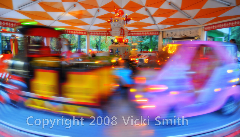 After a walk in the park we stoped for a drink and this childs carosel ride caught my eye. Milan, Italy public garden