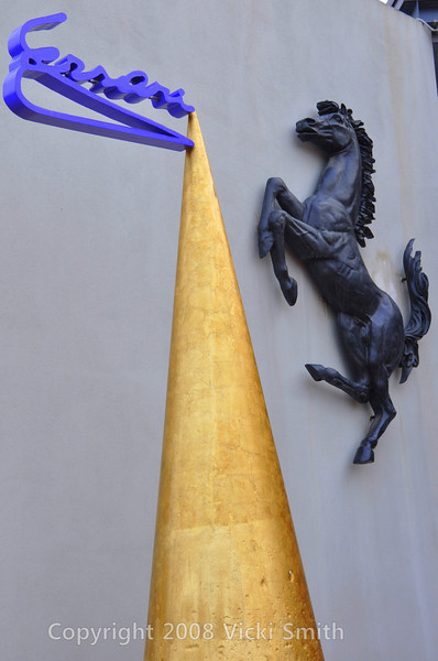 Maranello, Italy.  Home of Ferrari.  This is the entrance to the museum.  That gold cone is the tip of a pen.  Enzo Ferrari signed everything using a special purple ink, that's his signature at the tip of the pen.