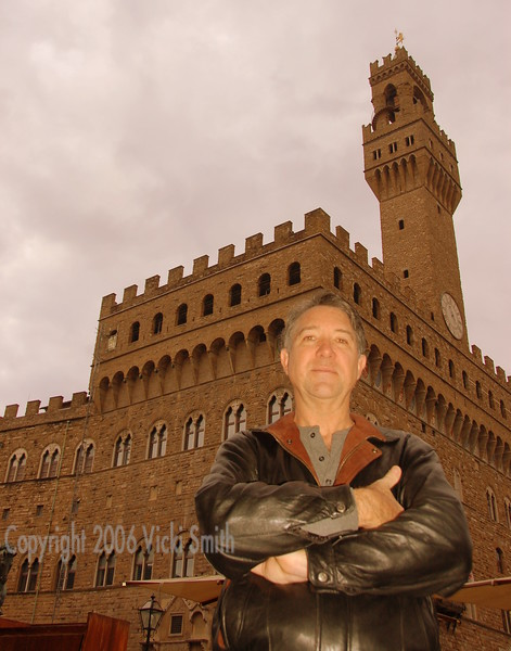 Shelby in the Piazza Signoria. Shelby is a commercial property manager back in Florida. I took this shot because I thought it showed the link between the man and his command of large structures.
