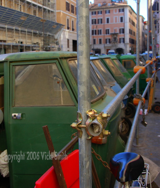 """These little Piaggio Apes (pronounced Ah-Pee) were all non running/missing parts. Rich called it the """"row of dead apes""""  There must have been 15 of them on the street right in the middle of the city"""