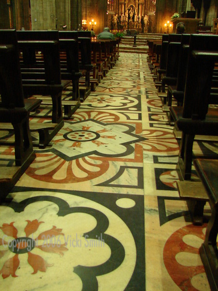 One of the smaller areas for reflection and prayer in the Duomo, the floors are spectacular mosaics of multi colored marble