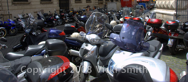 When many people think of Rome, it's with the famous Vespa movie scene. These days scooters rule the scene, this street was almost impassible for all the parked scooters