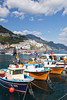 Boats in the harbour and a view of the town of Amalfi on the Gulf of Salerno in southern Italy.