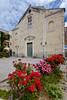 A church with rose bushes in Annunziata, Campania, Italy.