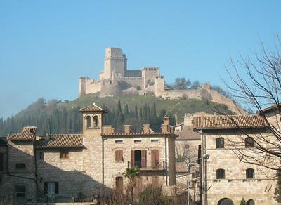 "The castle overlooking Assisi, called ""La Rocca"".  La Rocca."