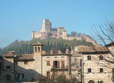 "The castle overlooking Assisi, called ""La Rocca"".  La Rocca."