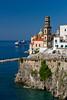 The picturesque fishing village of Atrani and a cruise ship on the Amalfi Coast, Campania, Italy.