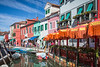 The colorful buldings, canals and boats in the Venetian vlllage of Burano, Venice, Italy, Europe.