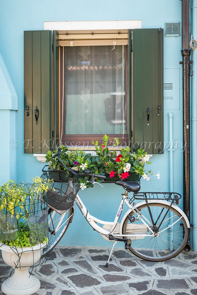 A decorative bicycle in the Venetian vlllage of Burano, Venice, Italy, Europe.