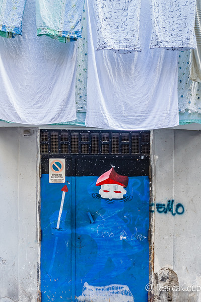 Graffiti Doorway With Laundry