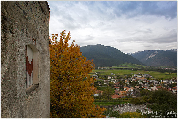 View of the Venosta (Vinschgau) valley, standing at the gate of the Churburg Castle (IT: Castel Coira) in South Tyrol, Italy