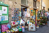 Shops and stores display their products in the narrow streets of Corniglia, Cinque terre, Italy, Europe.