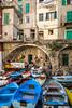 Colorful fishing boats in the village of Riomaggiore, Cinque Terre, Italy, Europe.