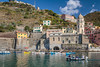 Fishing boats in the port in the village of Vernazza, Cinque Terre, Liguria, Italy, Europe.