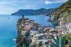 The coastline and Mediterranean Sea near the village of Vernazza, Cinque Terre, Liguria, Italy, Europe.