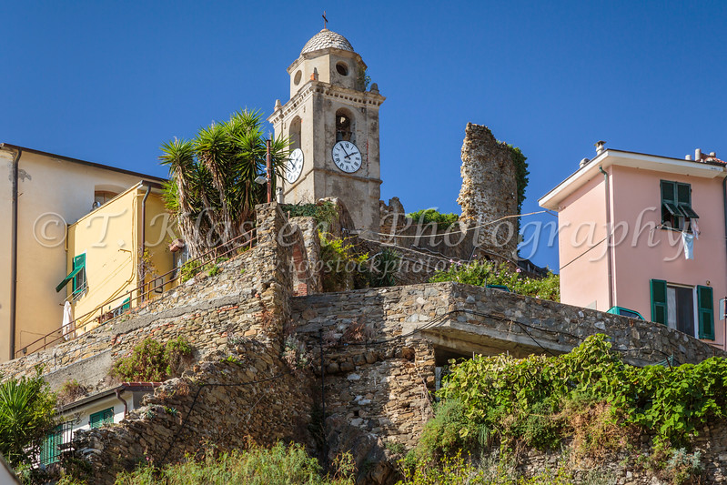 The clock tower in the village of Vernazza, Cinque Terre, Liguria, Italy, Europe.
