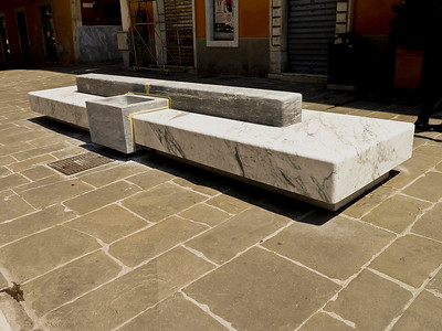 The benches in the public square in Carrea were made of marble. You can see that the waste baskets are also of marble.
