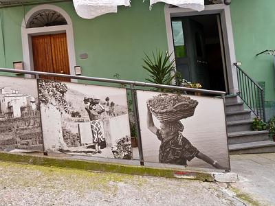 Town of Manarola.  Panels along a street showing older photos of the wine making in the regiion.